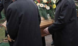 Pallbearers,Carry,A,Coffin,Decorated,With,Flowers